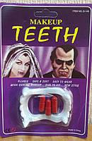 Зуби з кров'ю (аксесуар на Хеллоуїн)