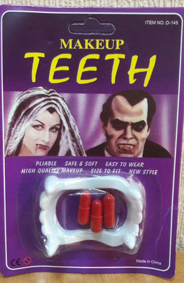 Зубы с кровью (аксессуар на Хэллоуин)