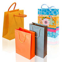 Пакети подарункові, пакувальний папір та аксесуари