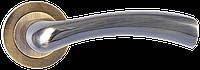 Ручка дверная Siba Saros на круглой  розетке( бронза)