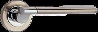 Ручка дверная Siba Truva на круглой  розетке( мат.никель/хром)