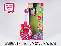 Муз. Гитара батар., свет, звук в кор. 51*23*8,5см (Муз. Гитара)