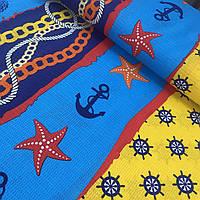 Вафельная ткань с морскими звездами, штурвалами и якорями, ширина 150 см
