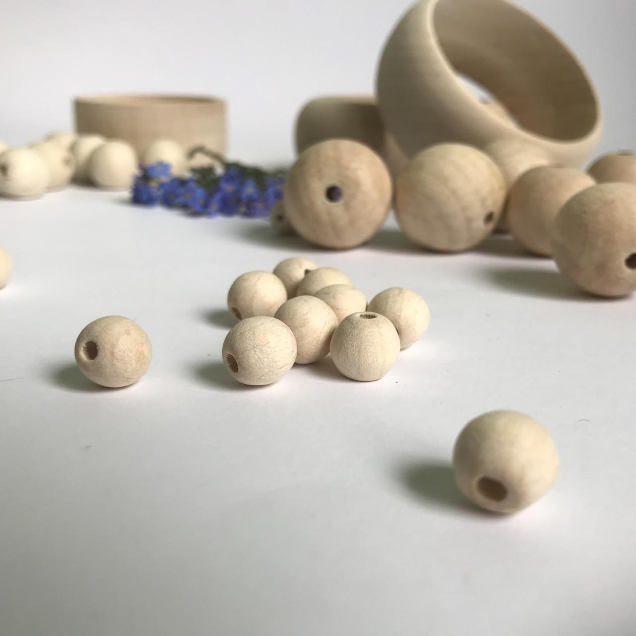 Дерев'янні намистини 1см натуральні.