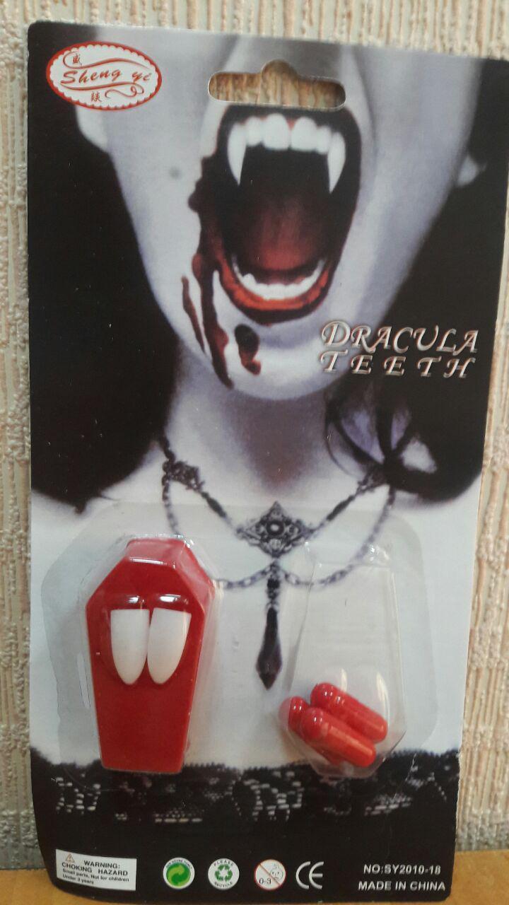 Клыки с кровью (клыки вампира)