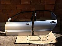 Стекло двери Mitsubishi Lancer