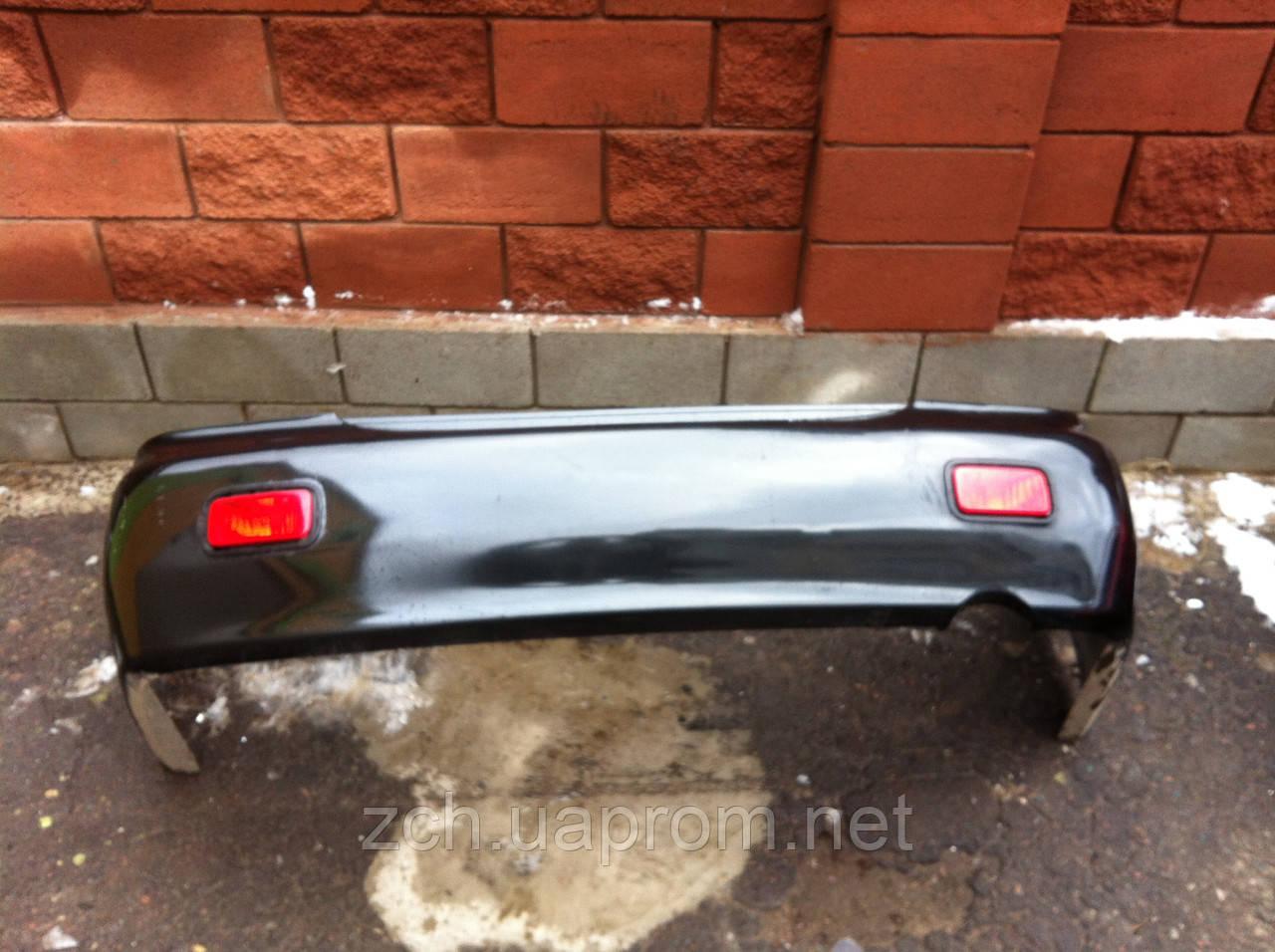 Бампер задний Mitsubishi Lancer