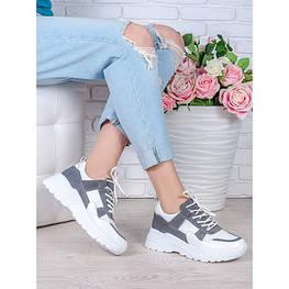 Кожаные кроссовки и сникерсы