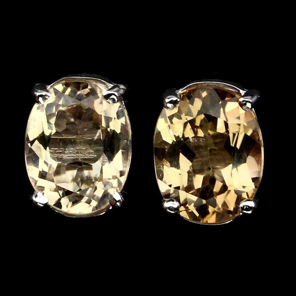 Срібні сережки з натуральними імперіал топазами 10х8мм