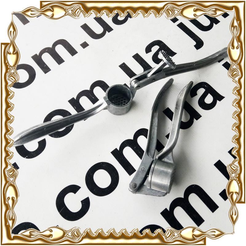 Прес для часнику (часникодавка) алюм. кругла, маленька №333