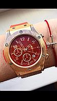 Часы в красном цвете
