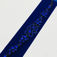 Браслет ажурный с синими камнями в черной оправе