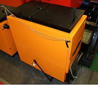 Неприхотливый надежный котел Холмова Ретра Komfort 40 кВт шахтный длительного горения