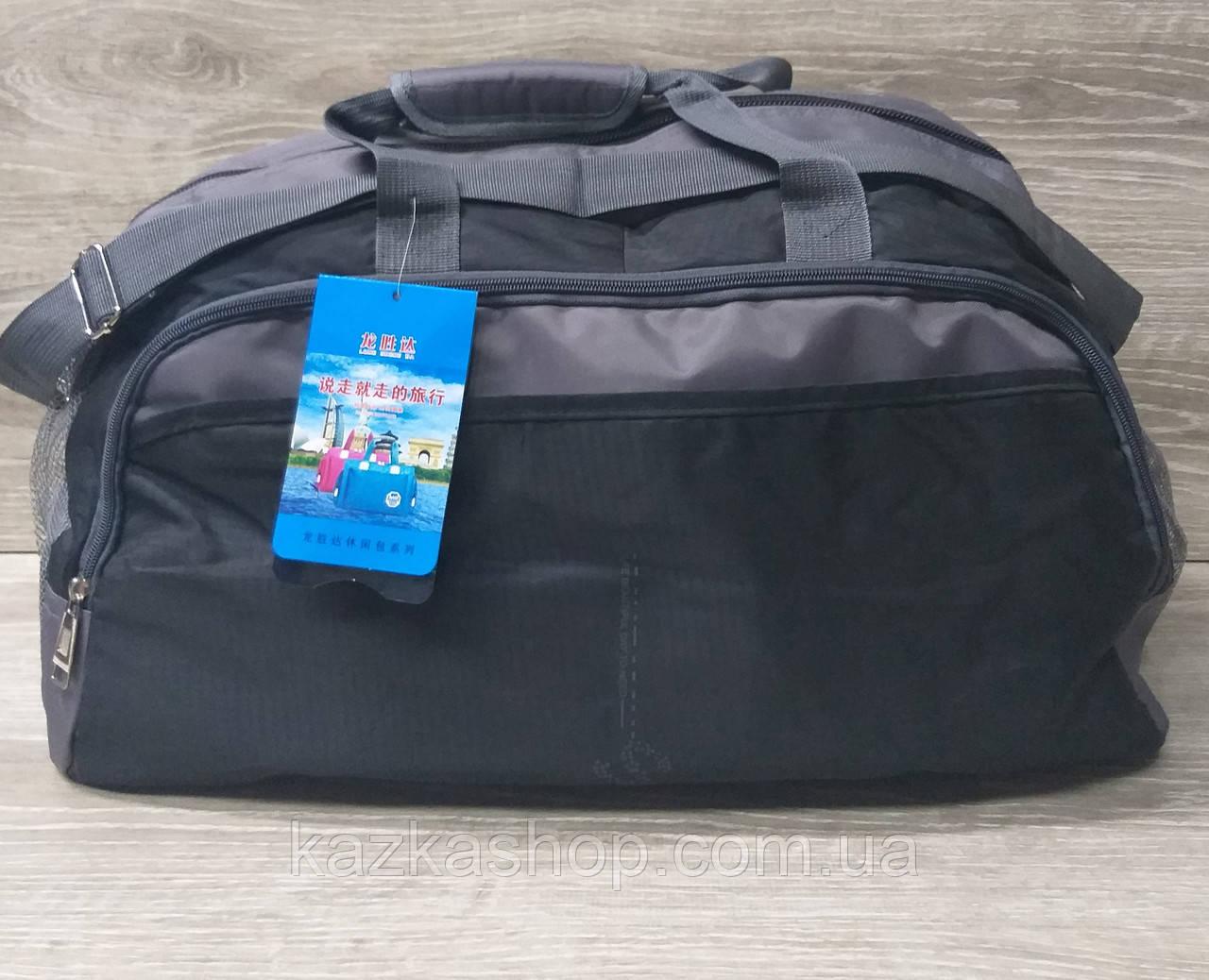Дорожная сумка хорошего качества, среднего размера 52х28х25 см, плотный материал, ножки на дне сумке