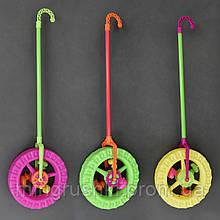 """Каталка """"Колесо"""" с трещёткой и погремушкой на палочке, 3 цвета, в кульке, 72см"""