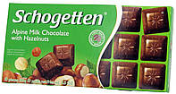 Шоколад молочный Schogеtten Alpine milk chocolate with Hazelnuts (с Орехом) 100г.