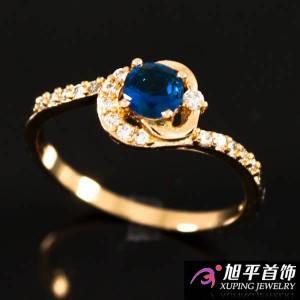 """Кольцо лимонное золото """"Синий камень в завитке с мелкими камнями"""""""