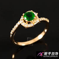 """Кольцо лимонное золото """"Зелёный камень в завитке с мелкими камнями"""""""