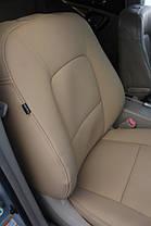 Чехлы на сидения Subaru из эко-кожи бежевого цвета.