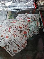 Красивый набор постельного белья с цветочным принтом