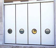ворота із круглими вікнами