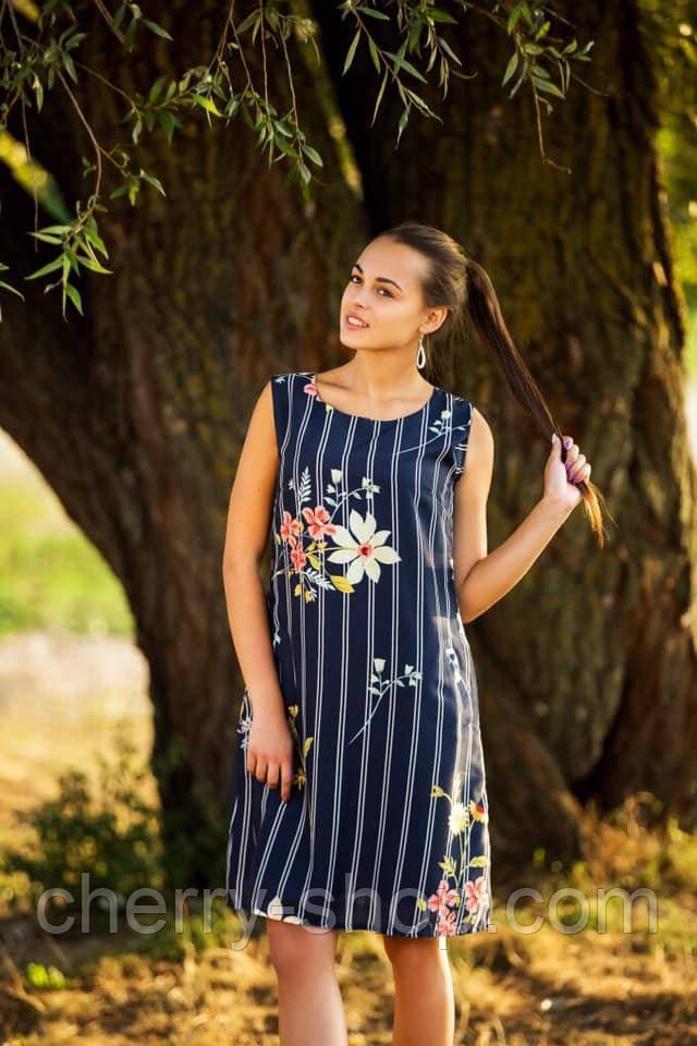 Синее женское платье в полоску с карманами