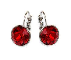 Серьги фирмы ХР, родий. Камни: Swarovski,  цвет: красный. Диаметр серьги: 10 мм. Высота: 1,7 см.