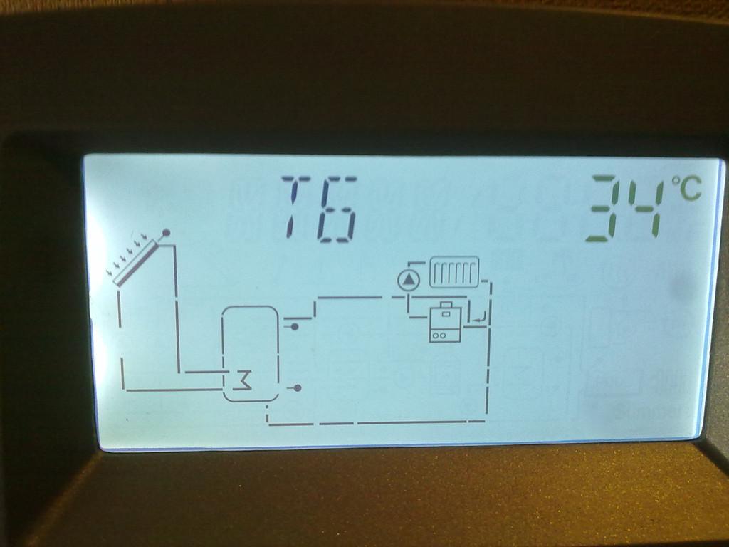 Температура обратной линии системы отопления (выполняется догрев через верхний ТО бойлера)