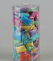 Одноразовые трусы - стринги из спанбонда с рюшами в тубусе микс Doily Colorful 25 шт