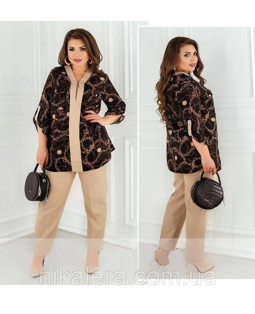 Костюм-двойка из блузы с принтом и брюк со стрелками
