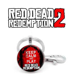 """Брелок Red Dead Redemption 2 с надписью """"Сохраняйте спокойствие и играйте в Red Dead Redemption 2"""""""