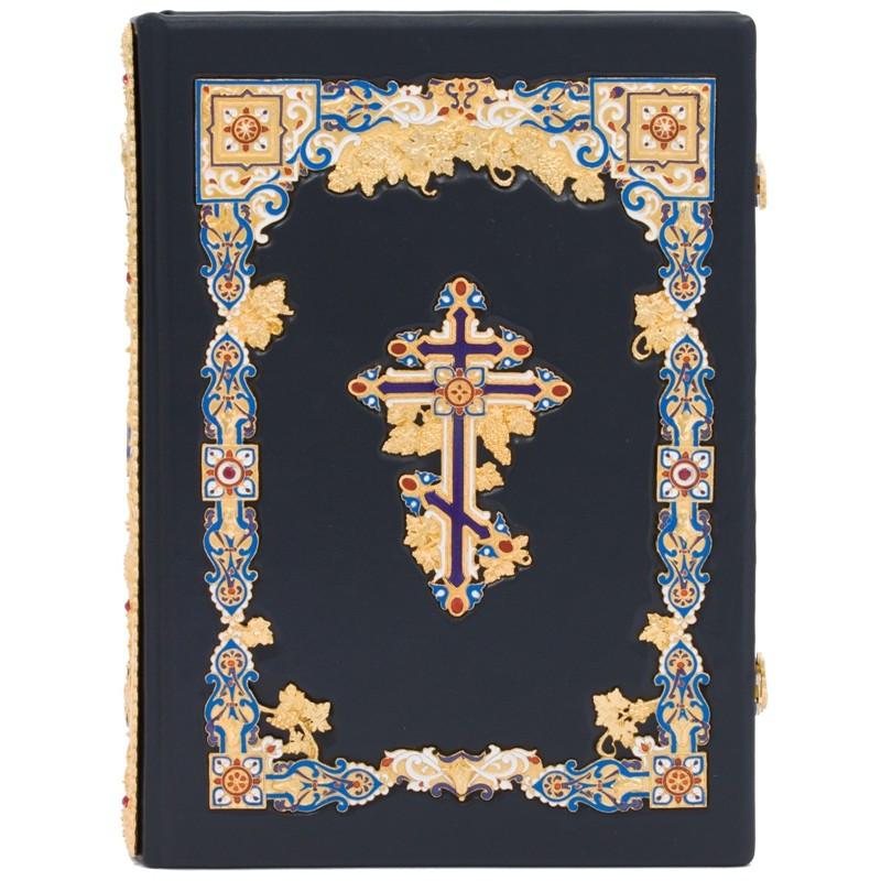 Библия в кожаном переплете декорирована позолотой и эмалями