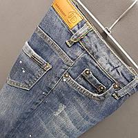 Детские джинсы декорированные каплями красок цвет синий