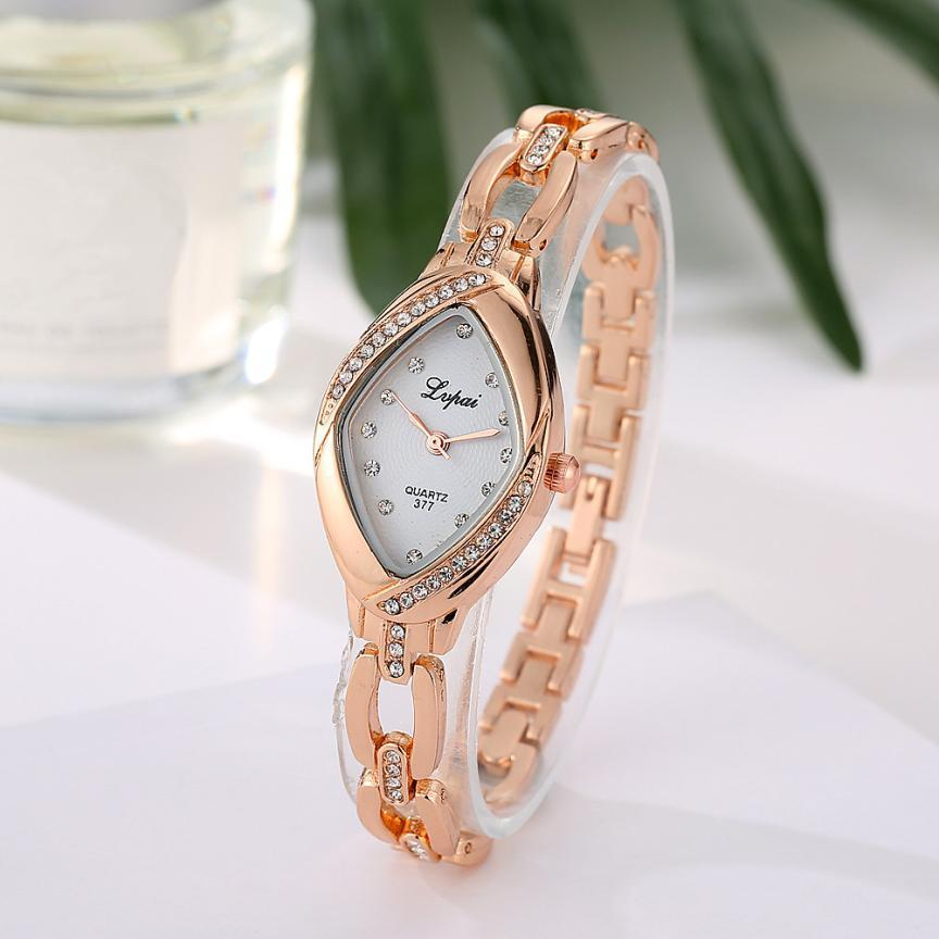 Наручные часы женские с золотистым ремешком и кристаллами код 328