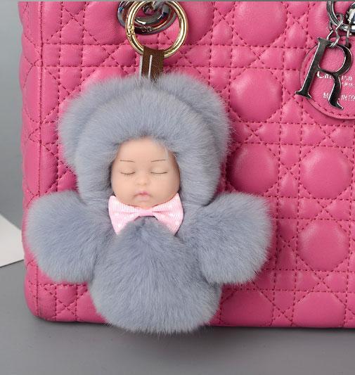 Меховой брелок на сумку. Куколка. 13 см. Розовый.