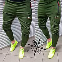 Мужские спортивные штаны зеленые с молниями на карманах и манжетами в области голени
