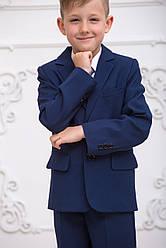 Школьный костюм для мальчика темно -синего цвета