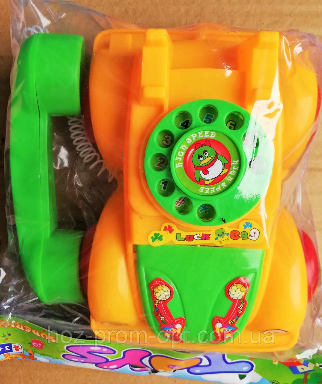 Каталка машина-телефон на шнурке в кульке..