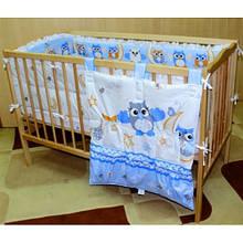 Комплект постільної білизни і приладдя в дитяче ліжечко