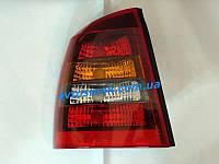 Фонарь задний для Opel Astra G седан '98-09 левый (DEPO) красно-дымчатый