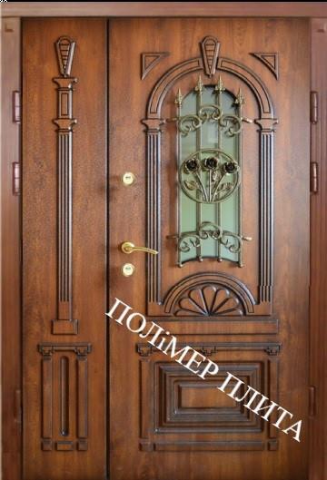 Двері вхідні з полімер плитою з ковкою