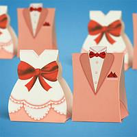 Бонбоньерки на свадьбу в виде жениха и невесты в оранжевых тонах
