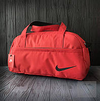 Недорогая спортивная сумка Nike красного цвета