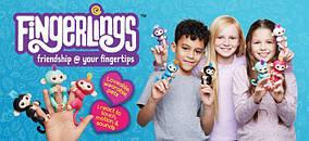 Fingerlings Ручная интерактивная обезьянка черная и белая оптом