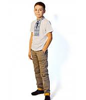 Футболка вишита хрестиком на хлопчика, білого кольору з синьо-голубою вишивкою