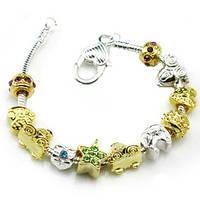Браслет Pandora  (Пандора). Красивые золотые шармы.