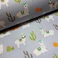 Ткань польская хлопковая, крупные ламы с кактусами на серо-голубом