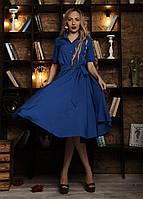 Летнее женское платье цвета електрик с пышной юбкой .