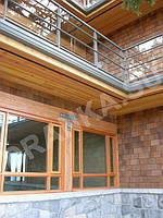 Фасади будинків з деревяних матеріалів: колотої дранки , шинделя, або деревяної черепиці.