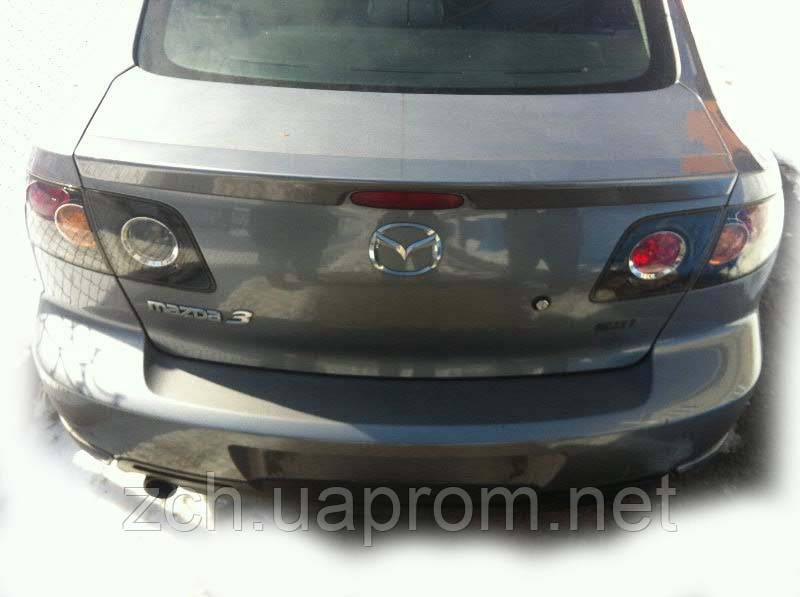 Трос багажника Mazda 3 sedan